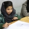 Afghan children learning to paint at the Aschiana Foundation paint Primary Health Care