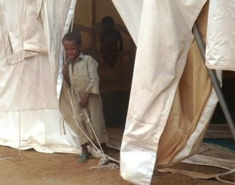 Boy in Yemen at entrance to tent