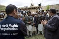 A mobile medical team in Afghanistan coordinating with a group of villagers