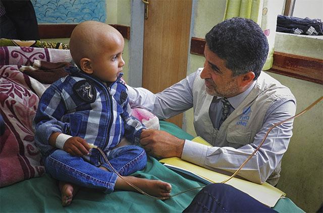 Dr Ahmed Al-Mandhari with Yemeni Kid