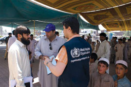 WHO staff work with Government of Pakistan staff to support relief efforts for flood affected areas