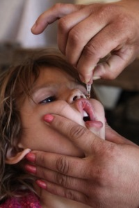 Child receiving an oral polio vaccine