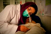 Community_midwife_from_Bamyan_province__listens_to_a_babys_heartbeat_Photo_Rada_Akbar_UNFPA_Afghansitan