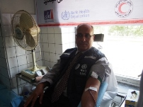 WHO's Health Cluster Coordinator Dr Abou Zeid donating blood at the World Blood Donor Day event in Kabul