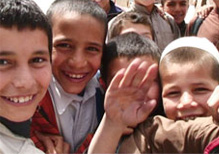 Group of young Afghani boys smiling at the camera