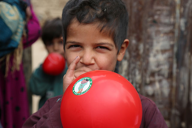 After receiving his polio vaccination, Waris gets a balloon. Loya Wala, Kandahar.