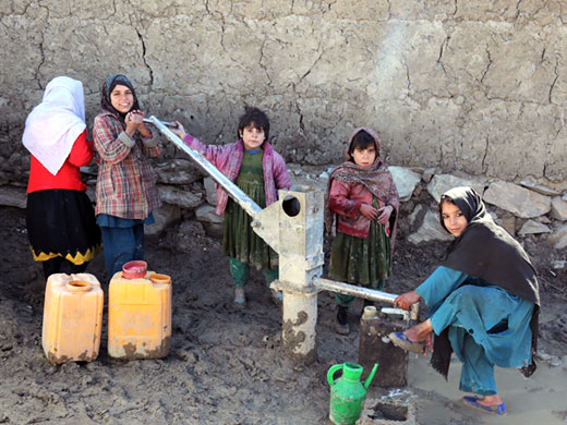 Credit: WHO Afghanistan/S.Ramo Children fetch water from a pump near the mobile clinic in the Nasaji Bagrami IDP camp. Most camps do not have electricity, running water or proper sanitation facilities. WHO is grateful for the support of USAID, ECHO and CHF that enabled the provision of essential health services for tens of thousands of Afghans in these camps for the past months. All 17 mobile clinics were closed in May 2017. With the support of WHO, the Ministry of Public Health is currently looking into alternative ways of supporting these much-needed essential health services for IDPs living in the camps.