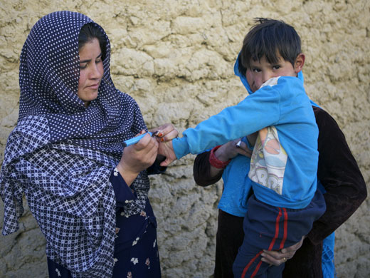 Credit: WHO Afghanistan/R.Akbar 24-year-old Sakina marks a child's finger with indelible ink to show he has been vaccinated. Sakina works as a volunteer polio vaccinator in Balkh province, northern Afghanistan. She is one of the over 66 000 frontline workers committed to protecting children's health around the country. Women like Sakina are at the heart of Afghanistan's polio eradication effort, creating ties with communities and building trust that enables vaccinators to reach every single child in all corners of the country.