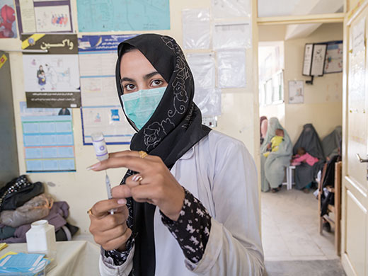 "Credit: WHO Afghanistan/G. Elham Sakina works as a vaccinator at a health centre in Kandahar province. ""Because there are not that many female vaccinators in this area, many mothers prefer to come here as they feel more comfortable if the vaccinator is a woman. People in my community know that I am working for polio eradication and they say it is a good thing. There are families who say that women should stay at home but this has never been a problem for me."""