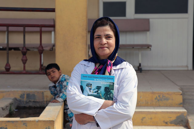 """Credit:WHO Afghanistan/S.Ramo Parwina Hassanzadah, medical doctor at the Nawabad Comprehensive Health Centre in Herat province """"In the training I learned a lot about gender-based violence and our role as healthcare providers in responding to it. I took the training 6 months ago and again I recently reviewed the GBV Protocol. Now I can identify GBV survivors, give them the medical treatment and information they need and support them in adopting positive coping mechanisms and doing safety planning. GBV is very common. Mainly I see women who are suffering from physical violence, for example beating by their husbands. Emotional violence is also common. I have been working as a medical doctor since I graduated from Kabul Medical University in 1993 and for the past 3 years I have worked at this clinic. It is so important that we uphold the key principles of respect, confidentiality, safety and non-discrimination when we are in contact with GBV survivors."""""""