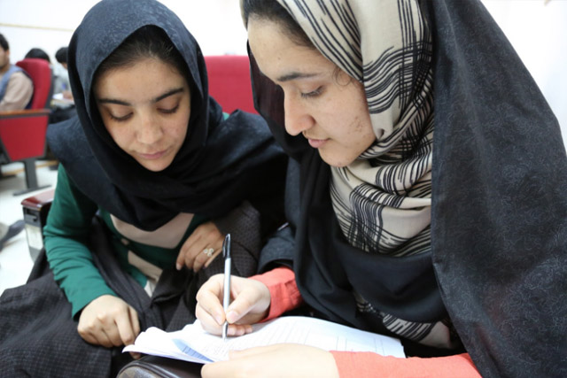 A week before vaccination campaign, the polio workers start preparing. More than 70,000 volunteer vaccinators and other polio workers are selected and trained in vaccination, finger marking and campaign monitoring. In Herat, students Jami Mansoora (left) and Asma Hakimi (right) were trained as campaign monitors.