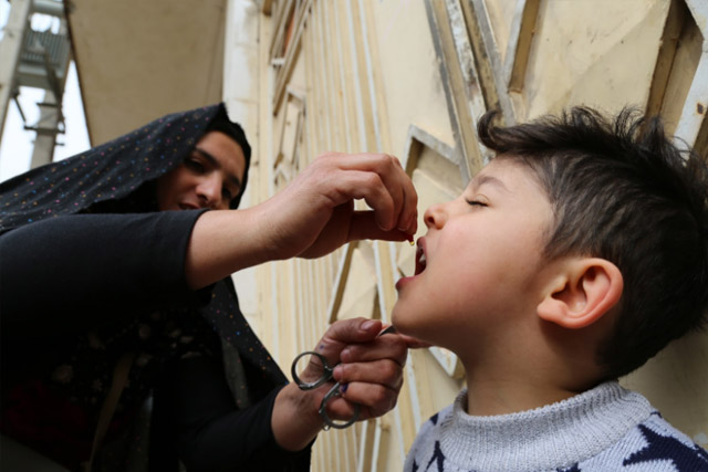 4-year old Ali Yaser was vaccinated on the first day of the campaign in Herat city. All vaccinated children were also given drops of vitamin A to boost their immunity.