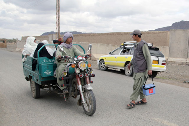 Credit:� WHO Afghanistan/J.Jalali 5) Reaching children in inaccessible areas Permanent transit teams (PTTs) help to reach children in inaccessible areas with vaccines. Currently 387 permanent transit teams, up from 163 in 2016, are stationed in strategically selected locations such as informal border crossings, busy transport hubs, major market places, health facilities and entry/exit points of inaccessible areas. The teams vaccinated over 10 million children in 2016. The number of PTTs is constantly modified according to the evolving security and access situation. The successful prevention of secondary cases and possible further transmission in Kunduz province in 2017 can be attributed to the 66 permanent transit teams placed around and inside the inaccessible areas of the province after house-to-house vaccination campaigns were banned.