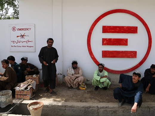 "Credit:� WHO Afghanistan/G.Elham Family members and friends wait outside the Emergency Surgical Centre in Lashkar Gah. ""My friend Nooryali was wounded in a battle with the Taliban and we are here to see him. I have visited him here many times since he was injured. The hospital provides very good facilities for visitors,"" said Mohammad, sitting outside the hospital with 7 of his friends. ""The security situation in Helmand is getting worse day by day. Many victims of the war do not reach hospitals and lose their lives on the way."""