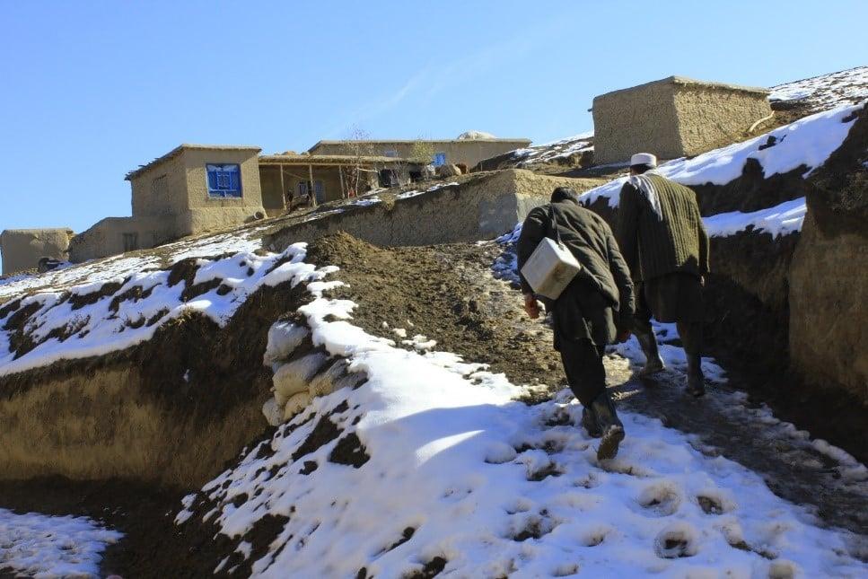 Volunteers, Abdul Basit and Misbahuddin in Aab-e-barik village, Argo district, Badakhshan province. Photo: Shaim Shahin/WHO Afghanistan