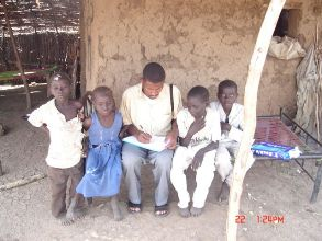 A surveillance officer collecting information from a group of children