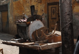 A photograph of a sweet potatoes peddler's cart