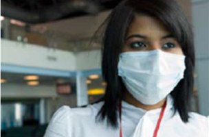 A photograph of a young woman wearing a facial protective mask
