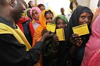 Women display their vaccination cards
