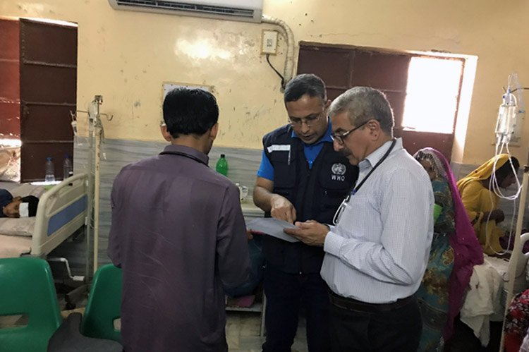 WHO staff inspecting a health center in Pakistan, where an outbreak of extensively drug-resistant typhoid fever started in 2016