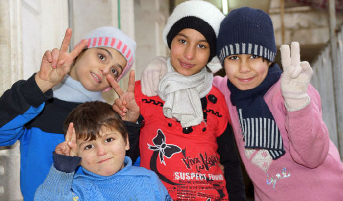 Children in eastern Aleppo were happy to be together after being evacuated