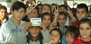 Group_of_children_smile_for_the_camera_during_the_oral_cholera_vaccination_campaign_in_Iraq