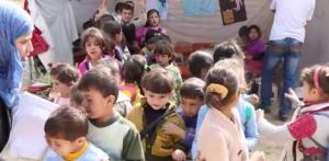 Syrian children in informal camp in Lebanon
