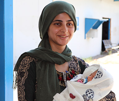 Hiba, a Syrian refugee visiting the PHCC in Darashakran camp to check her newborn baby