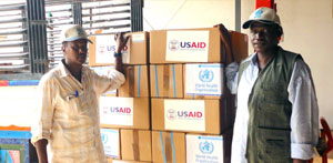 WHO staff loads Rapid Response Kits with medicine for 80 different common diseases onto a truck to be delivered to different locations across Darfur, Kordofan and Blue Nile