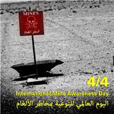 A red flag stuck into the ground indicates the possible presence of a landmine