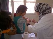 A young girl is vaccinated against measles as part of the vaccination campaign in Irbid and Mafraq
