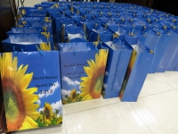 The sunflower on these complimentary gifts is the international symbol for World Mental Health Day.