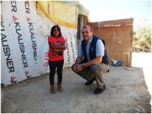 Dr Balladelli, WHO Regional Emergency Coordinator,  with Marah, a Syrian refugee, at a refugee settlement in Tripoli, Lebanon