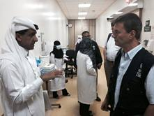 Members of the WHO mission discuss transmission patterns of the virus with local health authorities