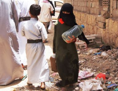 Young girl in Yemen holds empty water bottle