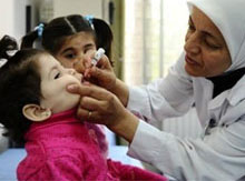 Syrian kid being vaccinated against polio