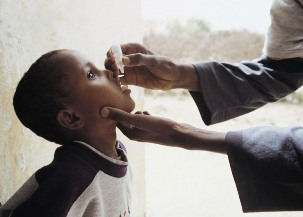 Child being immunized against polio in South Sudan