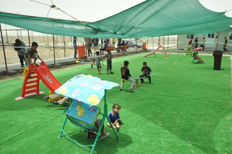 Play area inside the health centre; most children have not been immunized.