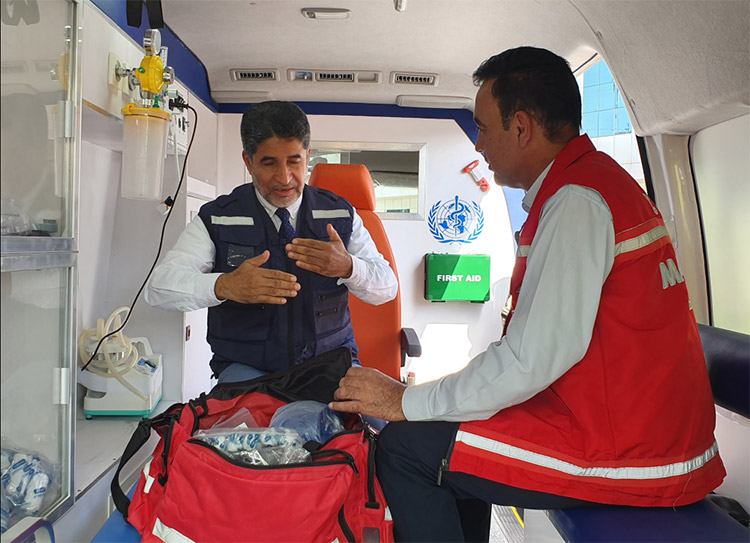 With a paramedic in a new ambulance donated by WHO to the Ministry of Health of Iraq