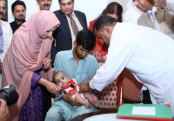 A child is vaccinated using inactivated polio vaccine (IPV) at the national launch of IPV in Routine Immunization in Islamabad, Pakistan, presided over by the Honorable Minister of State Mrs Saira Afzal Tarar