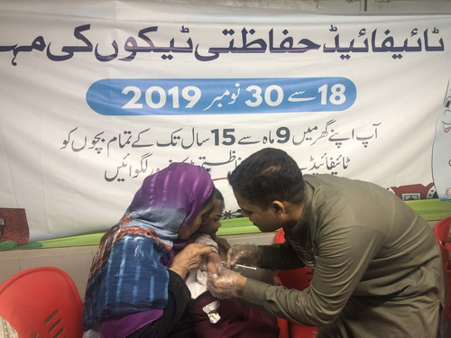 A_child_receiving_typhoid_vaccination_in_Sindh