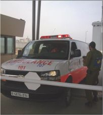 An ambulance held up at a checkpoint entering Hebron