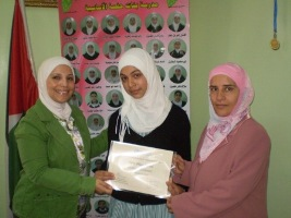 From_left_Dr._Tasneem_Atatrah_First_Prize_winning_student_Ghaida_Ameen_Tmeeze_and_School_Principle_Ghoson_Najar_