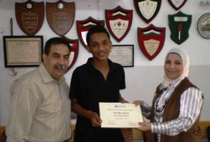 From_left_Mohammad_Mttor_Principal_Ramallah_Secondary_School_Fuad_Al_Yamani_First_Prize_Award_winner_and_Dr._Tasneem_Atatrah_WHO_oPt_Right_to_Health_Advocacy_Unit