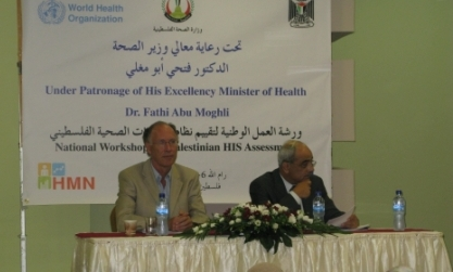 Tony Laurance, WHO Representative for oPt, at a table at teh front of the workshop on assessing health information systems with a representative of the Ministry of Health of oPt