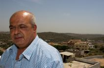 "Abu Rami, village council member, coordinates medical cases with the Israeli authorities for sick people to leave the ""Seam Zone"" village of Barta'a"