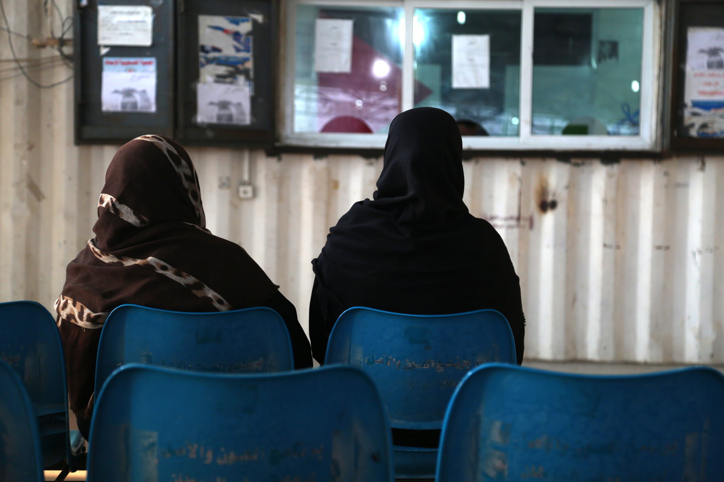 Women waiting at a cross point to exit Gaza for treatment