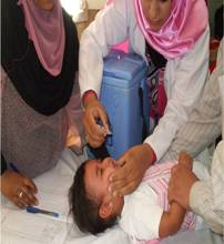 A child under 5 receiving polio drops