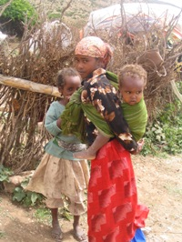 An image of three young children in a malaria-endemic area