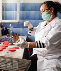 A female scientist conducting laboratory-based research